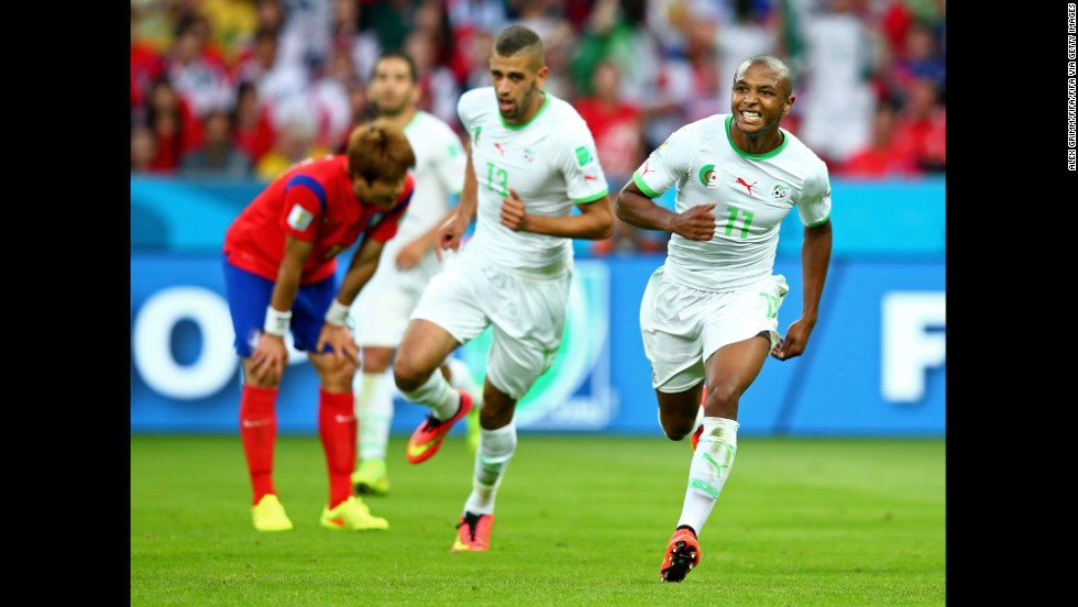 Yacine Brahimi of Algeria, right, celebrates scoring his team's fourth goal during a World Cup game against South Korea at Beira-Rio Stadium in Porto Alegre, Brazil. Algeria won 4-2, its first World Cup victory in 32 years.