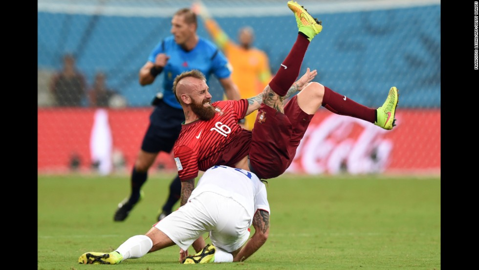 Portugal midfielder Raul Meireles and U.S. midfielder Kyle Beckerman tumble during the June 22 match in Manaus, Brazil.