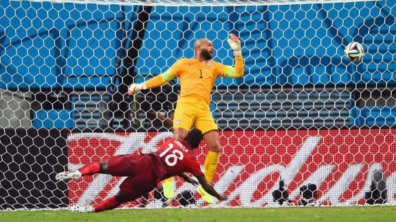 Talk about down to the wire. Silvestre Varela of Portugal scores his team's second goal past United States goalkeeper Tim Howard during a World Cup game at Arena Amazonia in Manaus, Brazil, on Sunday, June 22. The goal, scored with less than one minute left to play, led to a 2-2 draw.