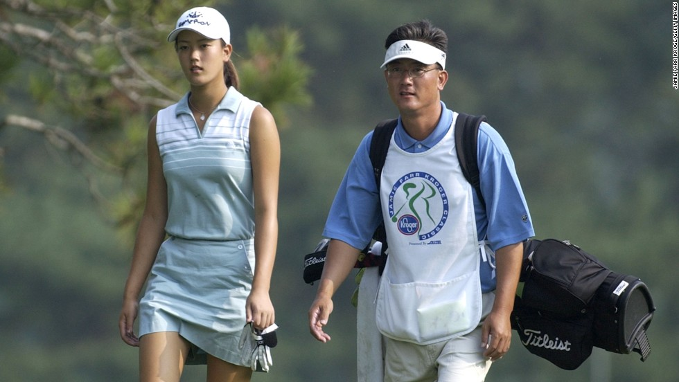 Wie first competed in an LPGA event when she was 12, then turned pro when she was 15. Here she appears with her father, B. J. Wie, at the LPGA Jamie Farr Kroger Classic in 2003 aged just 13.