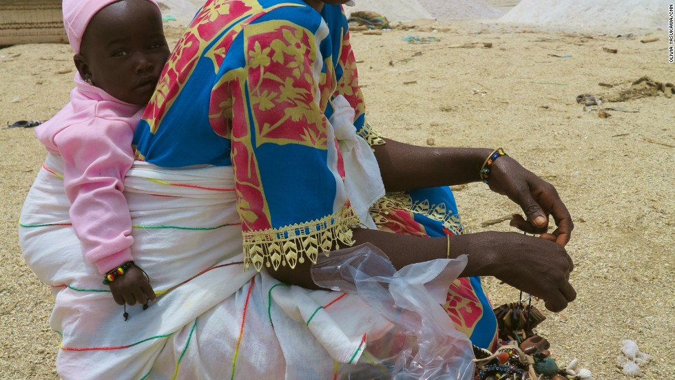 A woman selling jewelry on the shore of Lake Retba.