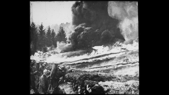 French soldiers making a gas and flame attack on German trenches in Flanders, Belgium, in 1918. German forces were the first to open valves on gas cylinders, releasing the toxic cloud on unprepared French troops in Ypres in 1915.