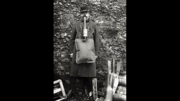 "A soldier demonstrates an ungainly French gas mask. ""French masks were notoriously unreliable,"" wrote historian Gerald Fitzgerald."