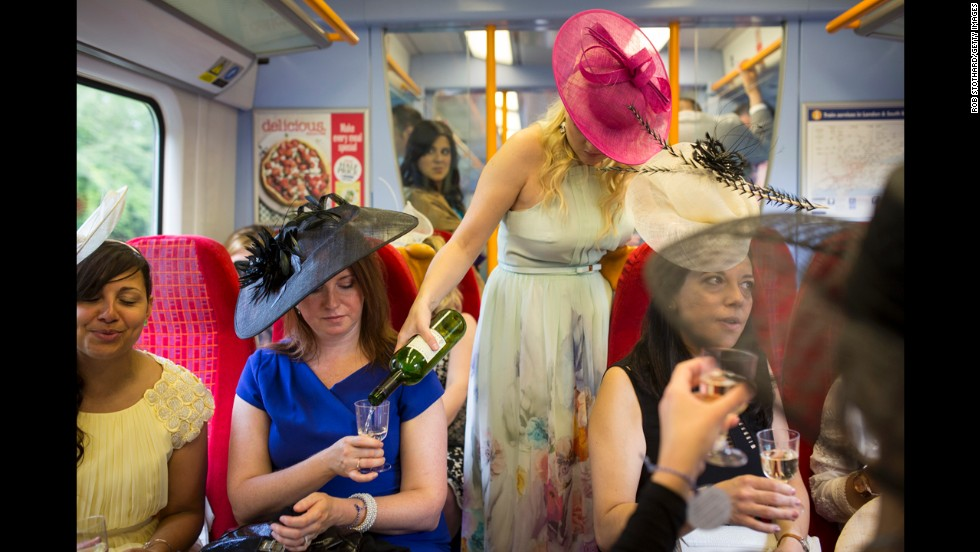 Racegoers travel by train on their way to Ladies Day at the Royal Ascot in London on Thursday, June 19.