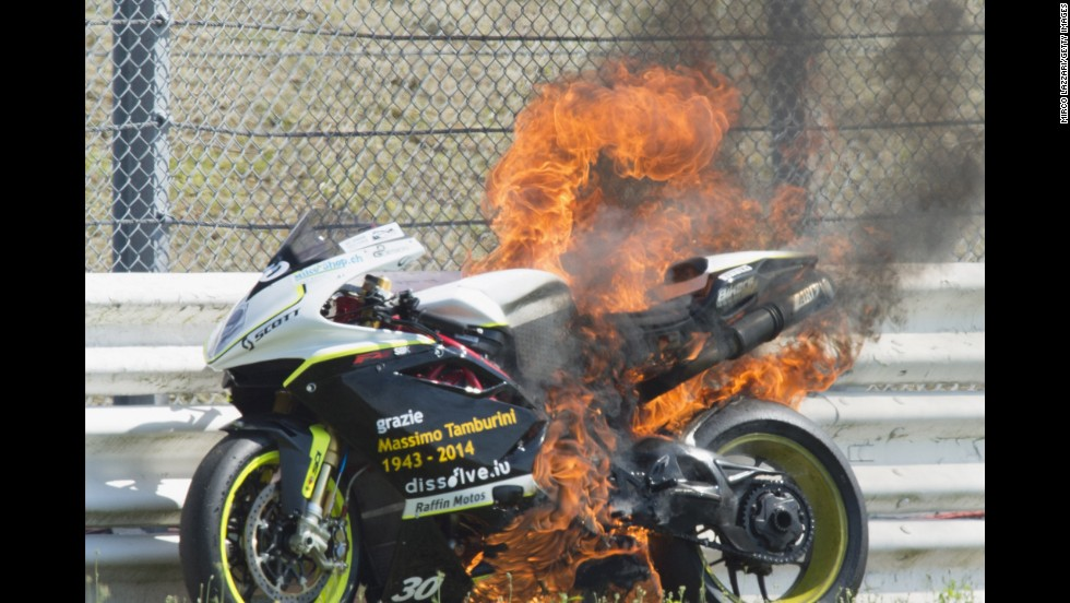 The bike of Switzerland's Michael Savary catches fire during the Superbike World Championship in Misano Adriatico, Italy, on Friday, June 20.