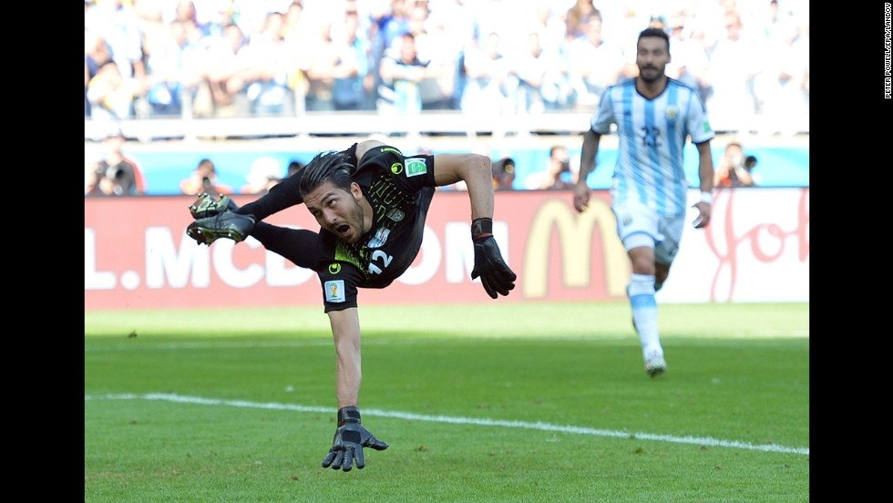 "Goalkeeper Alireza Haghighi of Iran fails to stop <a href=""http://www.cnn.com/2014/06/12/football/gallery/world-cup-goals/index.html"">a late goal</a> by Argentina's Lionel Messi during a World Cup match in Belo Horizonte, Brazil, on Saturday, June 21. Argentina won 1-0."