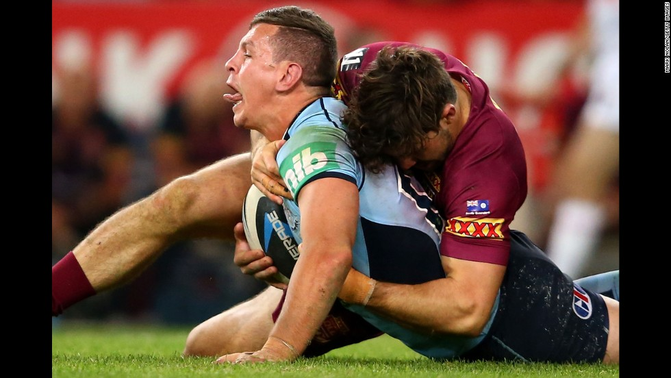 Greg Bird of the Blues is tackled during game two of the State of Origin rugby series between the New South Wales Blues and the Queensland Maroons on Wednesday, June 18, in Sydney.