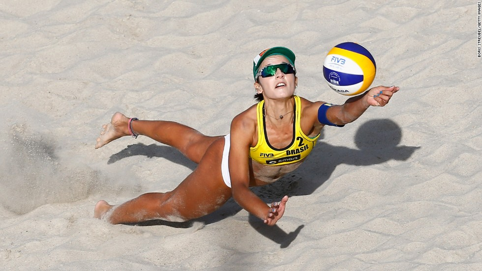 Barbara Seixas De Freitas of Brazil jumps for the ball while she and Agatha Bednarczuk take on Victoria Bieneck and Julia Grossner of Germany during the FIVB Berlin Smart Grand Slam in beach volleyball on Wednesday, June 18, in Berlin, Germany.