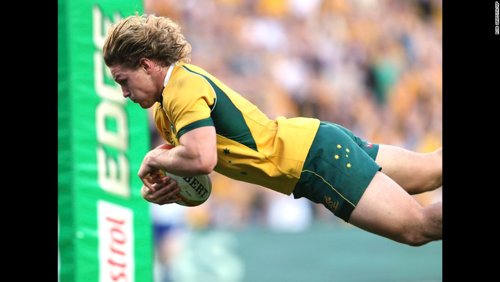 Australia's Michael Hooper drives to score a try during their Rugby Test Match against France in Sydney on Saturday, June 21.