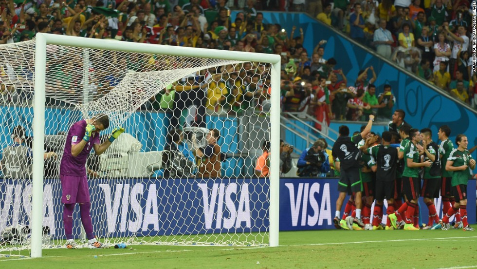 Croatian goalkeeper Stipe Pletikosa, left, reacts after Mexico scores.