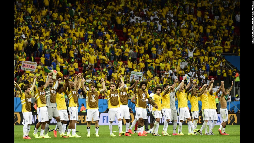 Brazilian players celebrate as they leave the pitch at the end of the match against Cameroon. Brazil won 4-1.