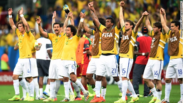 Brazil's players celebrate at the end of a Group A football match between Cameroon and Brazil at the Mane Garrincha National Stadium in Brasilia during the 2014 FIFA World Cup on June 23, 2014. AFP PHOTO / PEDRO UGARTE (Photo credit should read PEDRO UGARTE/AFP/Getty Images)