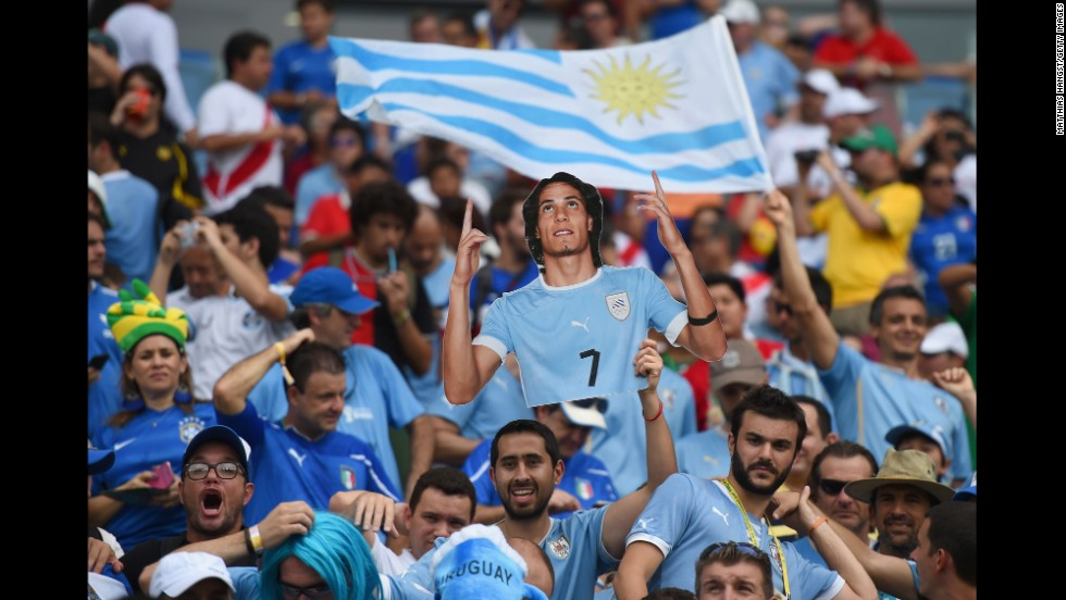 A Uruguay fan holds a cutout of Cristian Rodriguez ahead of the match against Italy.