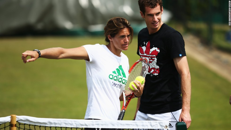 Andy Murray talks with coach Amelie Mauresmo during a practice session ahead of Wednesday's second-round match against Blaz Rola.