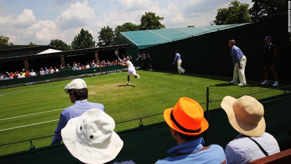 Spectators enjoying the sunshine on one of the All England Club's outer courts.