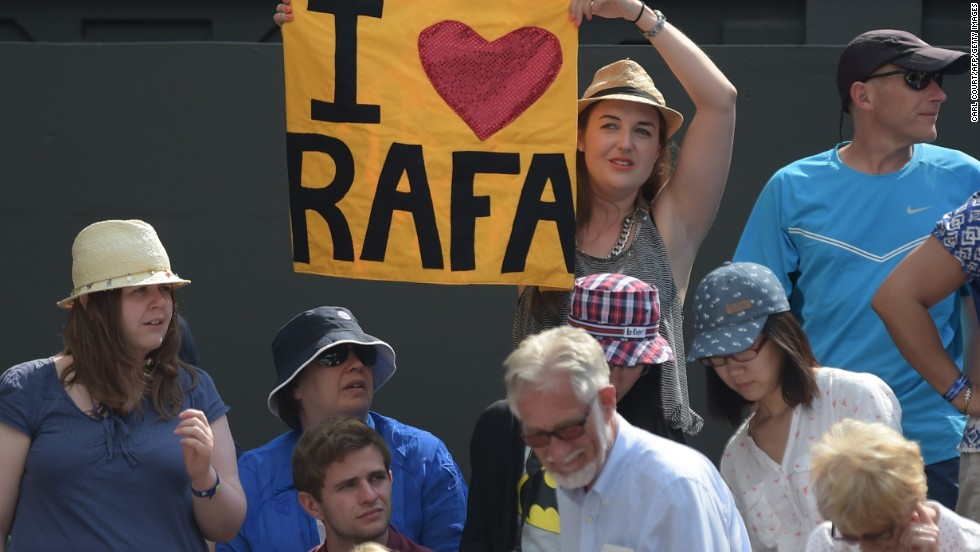 A spectator holds up a sign supporting Nadal during his match with Klizan.