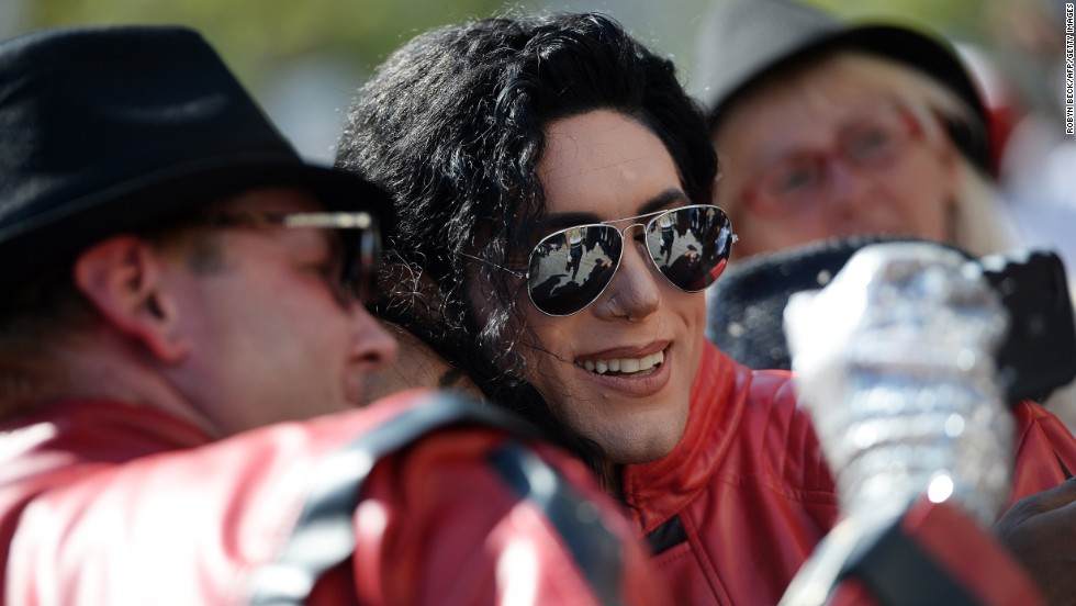 Michael Jackson impersonator Michael Lange poses for a selfie with other performers after a flash mob tribute dance in Santa Monica, California, on Sunday, June 22. The fifth anniversary of Jackson's death is on June 25.