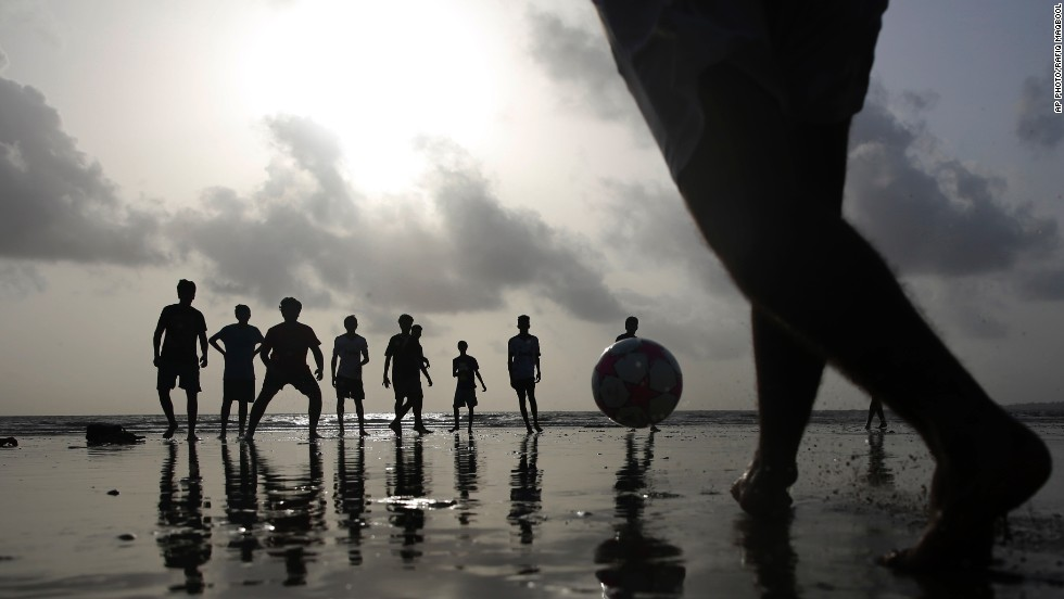 "JUNE 24 - MUMBAI, INDIA: Indian youths play football on the coast of the Arabian Sea in Mumbai, India. Although India has not qualified for the <a href=""http://cnn.com/2014/06/12/sport/football/world-cup-schedule-of-matches/index.html"">FIFA World Cup</a>, which is running at the moment,<a href=""http://cnn.com/2013/04/25/sport/football/indian-football-manchester-united/""> FIFA president Sepp Blatter once described Indian football as a ""sleeping giant.""</a>"