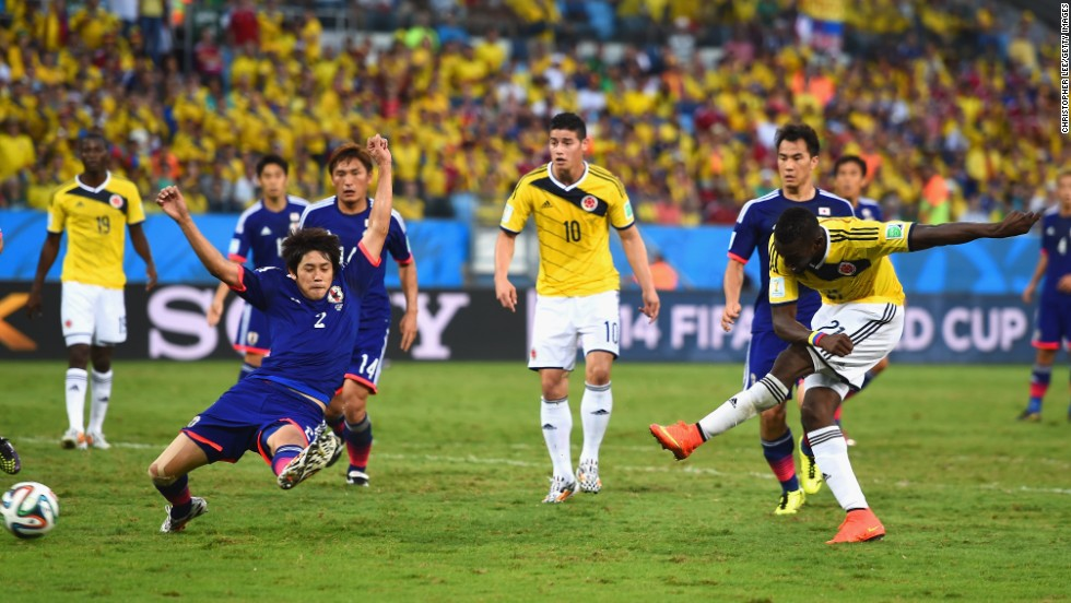 Jackson Martinez of Colombia shoots and scores his team's second goal against Japan.
