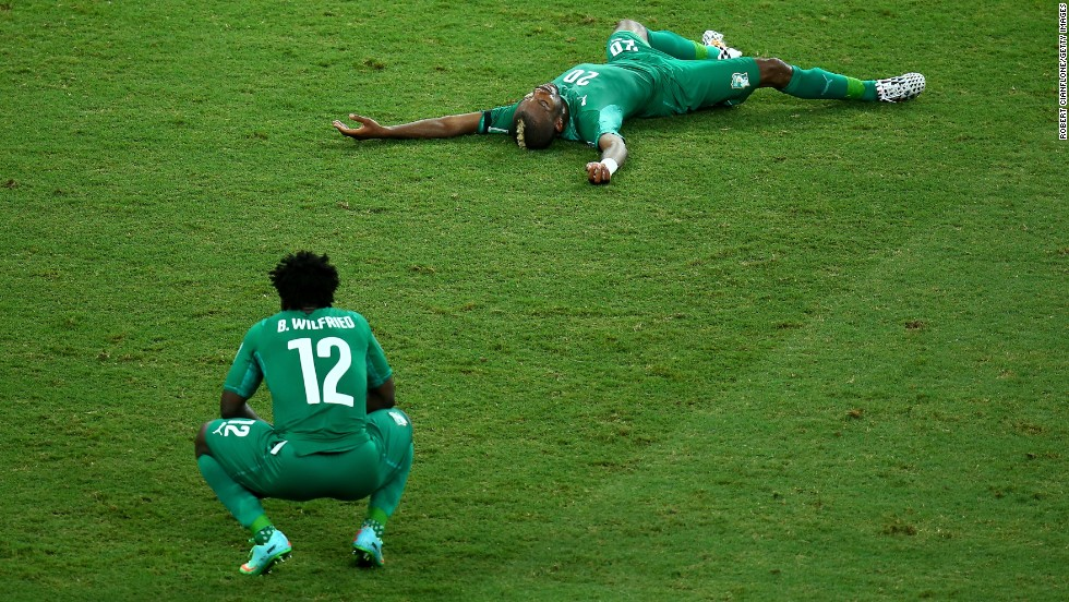 A dejected Wilfried Bony, left, and Die Serey of the Ivory Coast react after being defeated by Greece 2-1 during a World Cup match on Tuesday, June 24, in Fortaleza, Brazil.