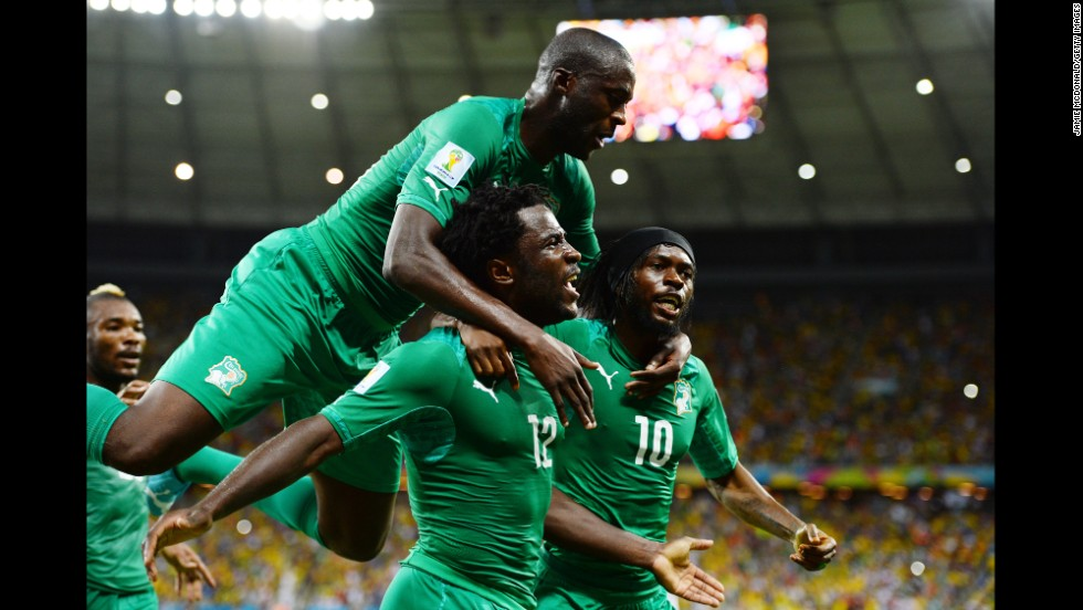 Wilfried Bony of the Ivory Coast celebrates scoring his team's first goal with Yaya Toure, left, and Gervinho.