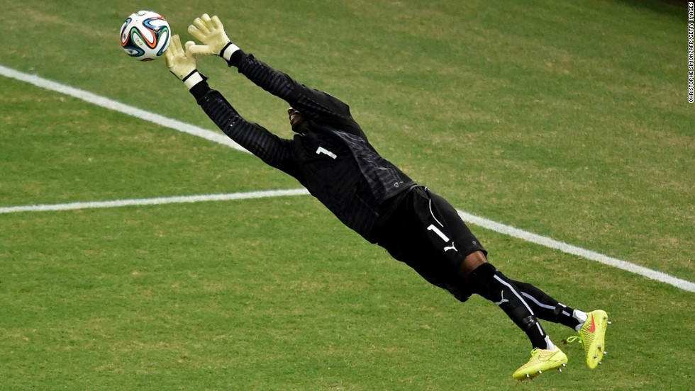 Ivory Coast's goalkeeper Boubacar Barry makes a save against Greece.
