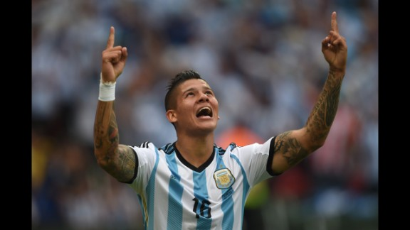 Argentina defender Marcos Rojo celebrates his team's third goal against Nigeria in Porto Alegre, Brazil, on June 25. Argentina won 3-2.