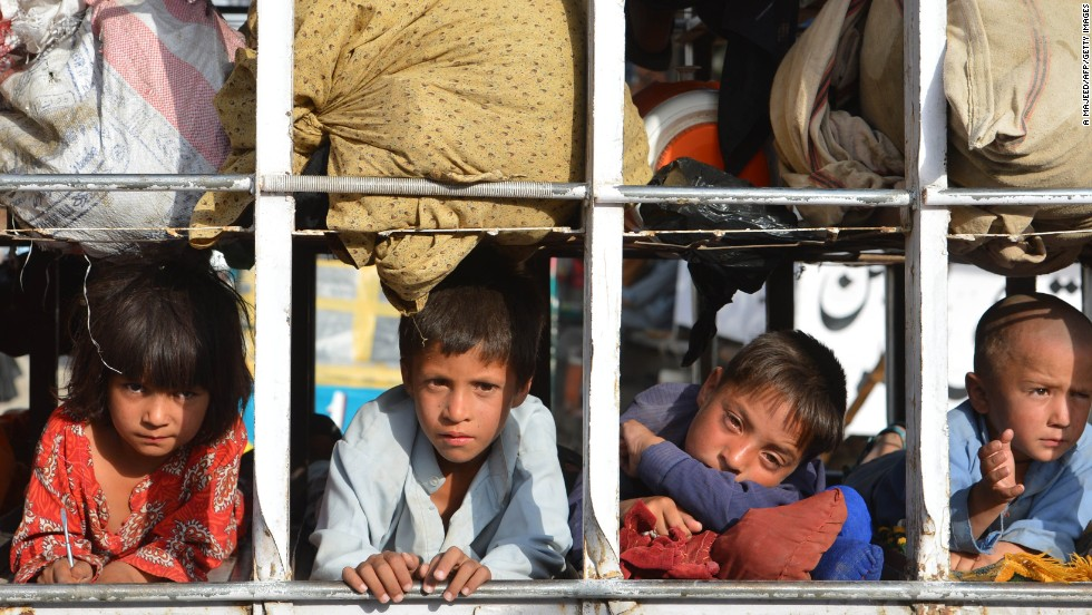 Pakistani children arrive by truck in Bannu, after fleeing the North Waziristan tribal region on June 20. As of Wednesday, 455,000 people had fled, according to the United Nations and the government.