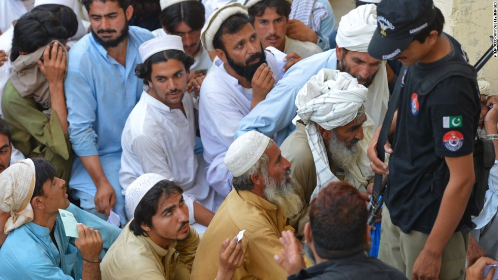 Civilians gather to receive food aid on June 23. Many have opted to stay with family or rent accommodation rather than residing in the government-run camp.