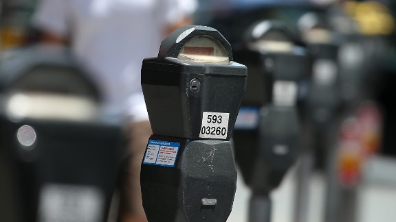 Parking meters line O'Farrell Street in San Francisco, whose parking ticket fees are the highest in the country.