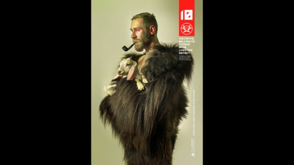 District 10's Felix Stam wears fur and cradles a goat in tribute to being from the Livestock District.