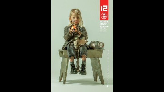 """All hail The Capitol! In anticipation of the November 2014 release of """"The Hunger Games: Mockingjay Part 1"""" the franchise has released posters of """"district heroes"""" representing their areas. Here Lily Elsington, the 6-year-old ambassador from the Mining District, District 12, is shown."""