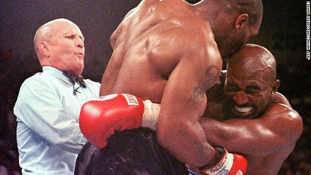 Referee Lane Mills stepped in after Mike Tyson bit Evander Holyfield's ear in the third round of their 1997 WBA Heavyweight Championship Fight at the MGM Grand Garden Arena in Las Vegas, NV.