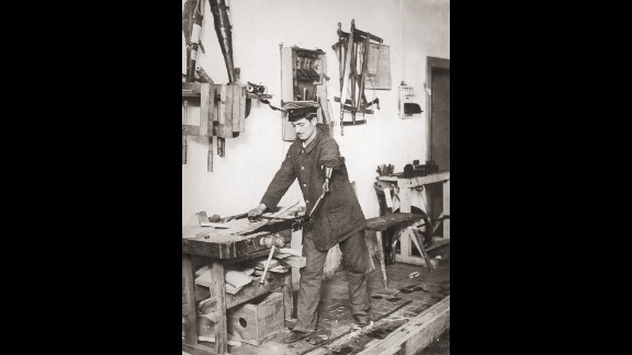 A disabled German ex-serviceman works as a carpenter with the aid of a prosthetic arm, Germany, circa 1919.