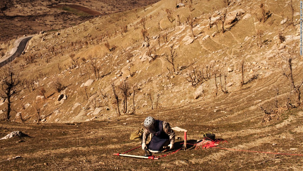 A deminer from Iraqi Kurdistan Mine Action Agency practices next to a mine field in the Iraqi village of Mawilian. The mines were placed by the Iraqi Army during the Iraq-Iran war in the 1980s. Marco di Lauro, who photographed the Iraq War in 2003, returned in 2014 to document the country's struggles with landmines.