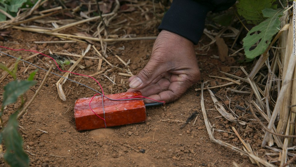 A member of the UXO Lao clearance team gets ready to detonate munitions found after a day of work in the Lateuang village. The government-run organization has been clearing land mines in Laos since 1996.