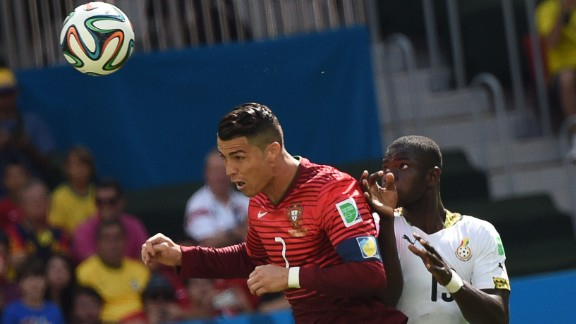 Portugal forward Cristiano Ronaldo and Ghana defender Jonathan Mensah vie for the ball.