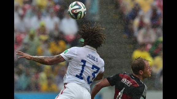 Jermaine Jones of the United States and Benedikt Hoewedes of Germany jump for the ball during their game in Recife.
