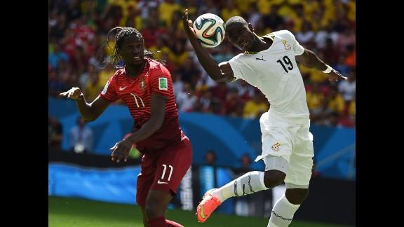 Eder of Portugal and Jonathan Mensah of Ghana jump for the ball.