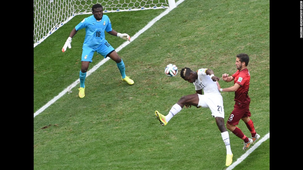 Ghana defender John Boye, center, hits the ball to score an own-goal as Portugal midfielder Joao Moutinho, right, watches on and Ghana goalkeeper Fatau Dauda tries to defend on June 26.