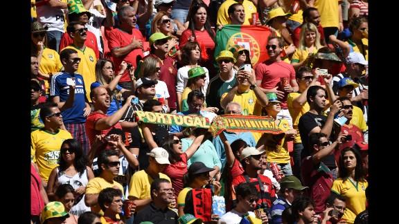 Portugal fans cheer before their team