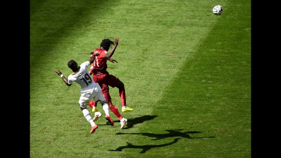 Jonathan Mensah of Ghana and Eder of Portugal go up for the ball.