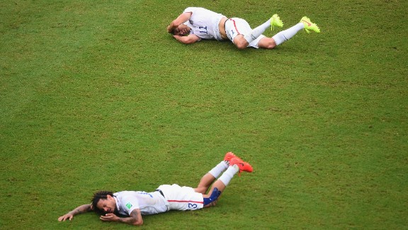 Jermaine Jones, front, of the United States and teammate Alejandro Bedoya lie on the field after colliding during a match against Germany.