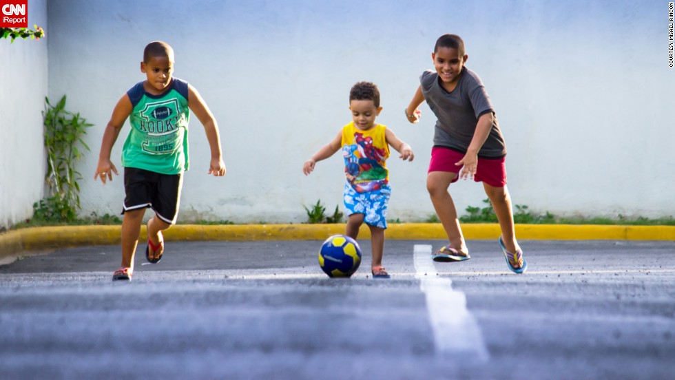 "Whether you call it soccer or football, this game is beloved around the world. In the Dominican Republic, Misael Rincon's kids and their cousin ""have <a href=""http://ireport.cnn.com/docs/DOC-1144246"">World Cup fever</a>!"" Here, they race for the ball outside Rincon's Santo Domingo home. ""My kids love the baseball but for a few days here [they] have replaced the bat and glove for a football,"" he said. Click through the gallery to see more joyful photos that illustrate the world's love affair with soccer."