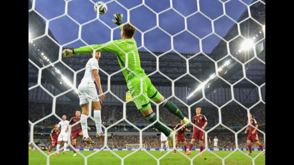Igor Akinfeev of Russia makes a save against Algeria.