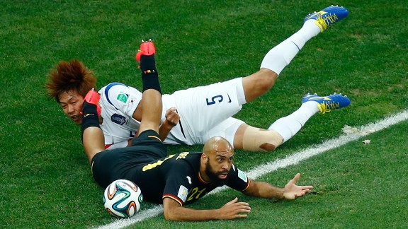 South Korea defender Kim Young-Gwon  and Anthony Vanden Borre of Belgium collide during the match between South Korea and Belgium on June 26 in Sao Paulo, Brazil.