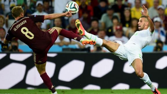 Islam Slimani of Algeria and Denis Glushakov of Russia compete for the ball.