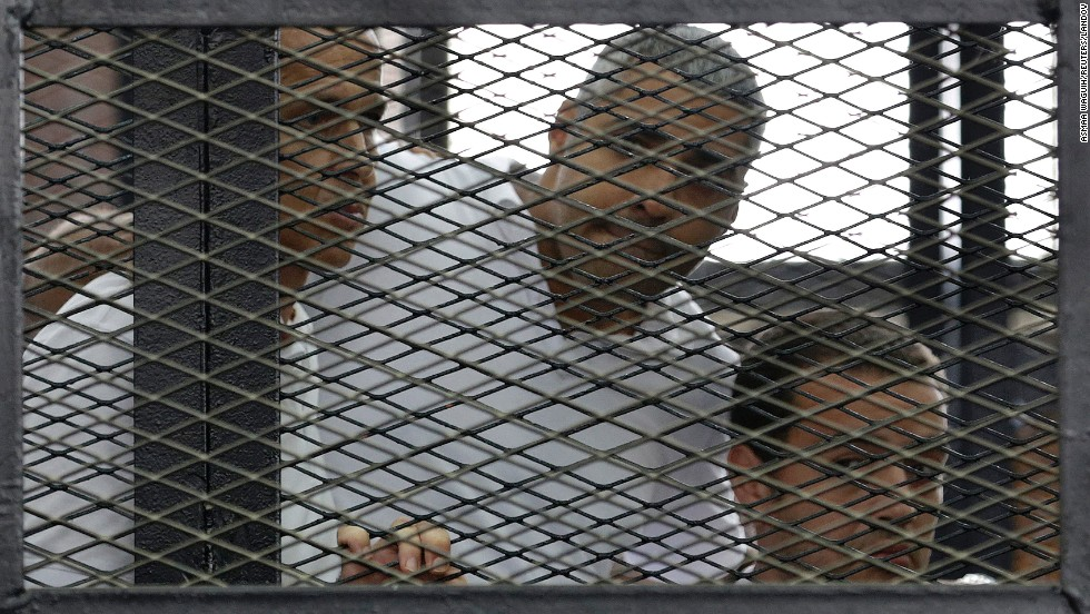 From left, Peter Greste, Mohamed Fahmy and Baher Mohamed listen to a court ruling in Cairo on Monday, June 23. The three Al Jazeera journalists were sentenced to seven years in jail after they were convicted of spreading false news and conspiring with the Muslim Brotherhood. The case has outraged journalists and raised questions about the country's respect for media freedoms.
