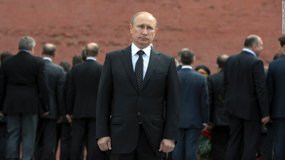 Russian President Vladimir Putin attends a ceremony near the Kremlin walls in Moscow on Sunday, June 22, to commemorate the anniversary of the Great Patriotic War against Nazi Germany in 1941.