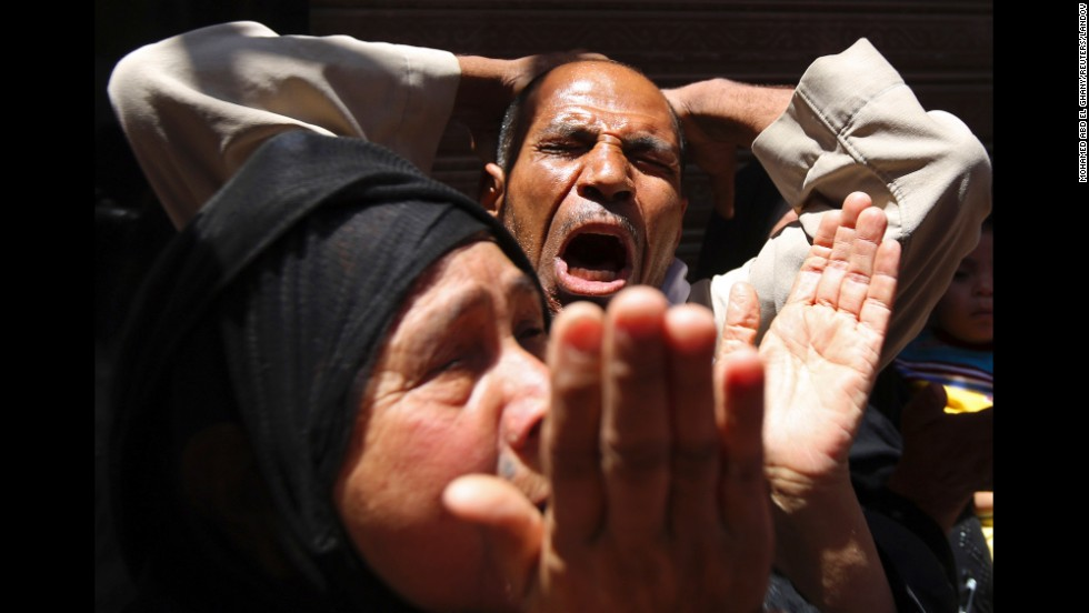 Relatives and supporters of the Muslim Brotherhood react outside an Egyptian court in Minya, south of Cairo, on Saturday, June 21. The court upheld death sentences against Muslim Brotherhood leader Mohamed Badie and 182 of the group's supporters.